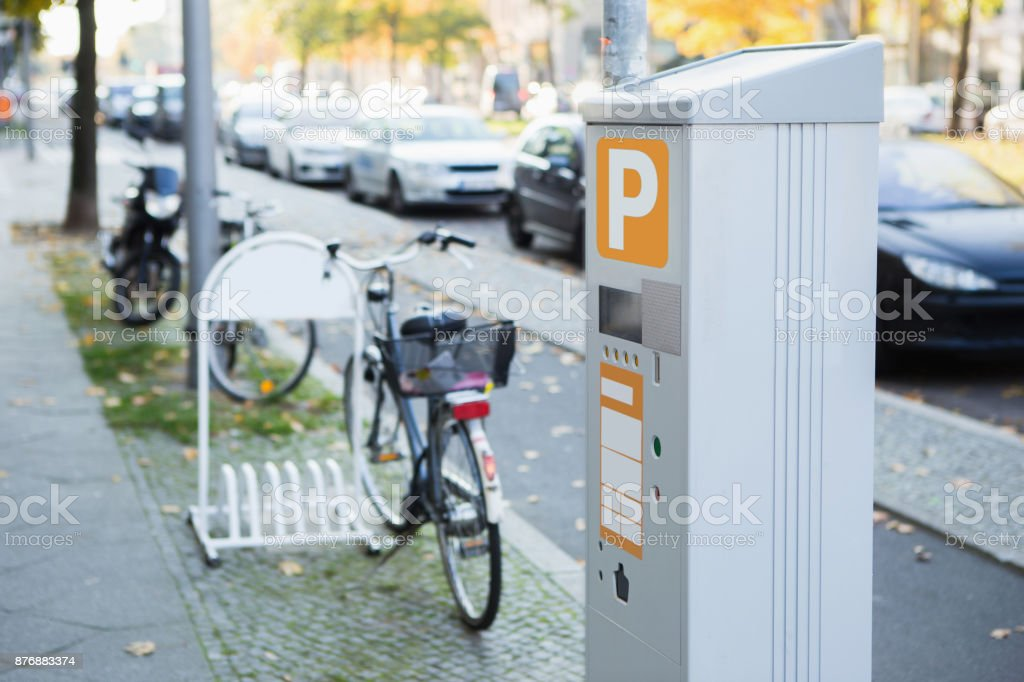 Parking machine with solar panel in the city street. stock photo