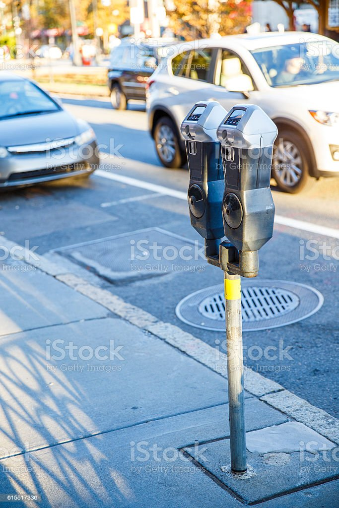 parking meter on a city street stock photo