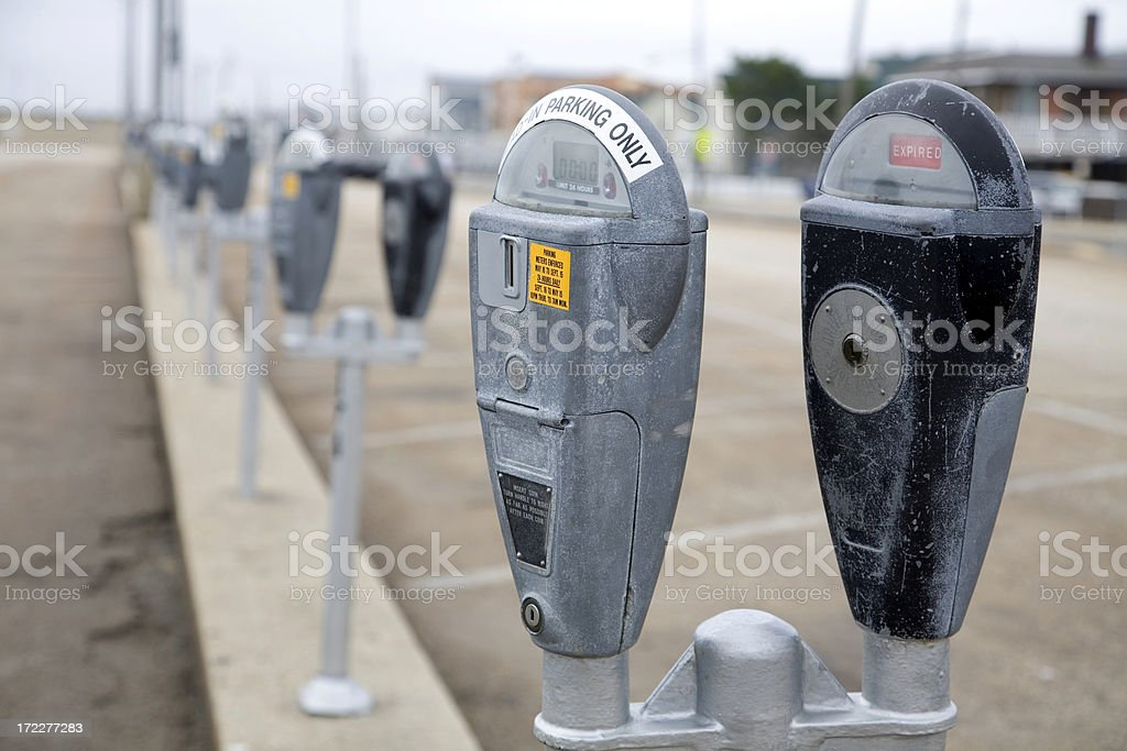 Parking Meters in Parking Lot Closeup royalty-free stock photo