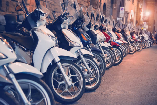 Parking scooters in a row by night stock photo