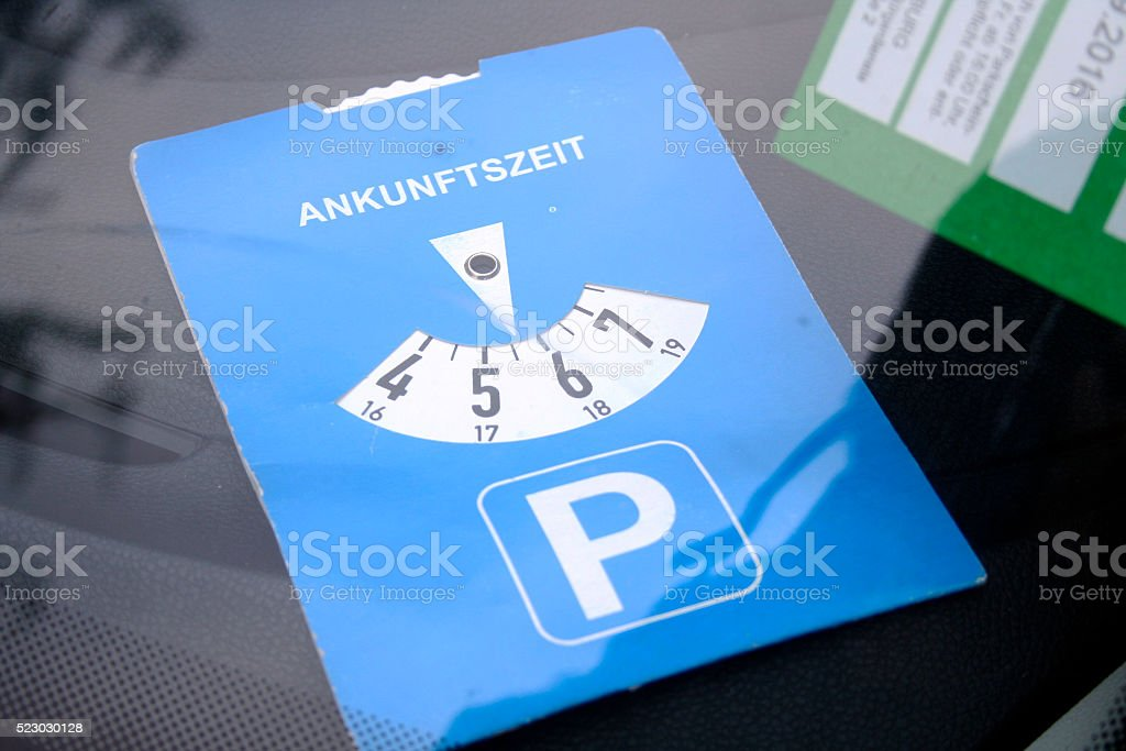 Parking Sign - Blue Parking Disc on White stock photo
