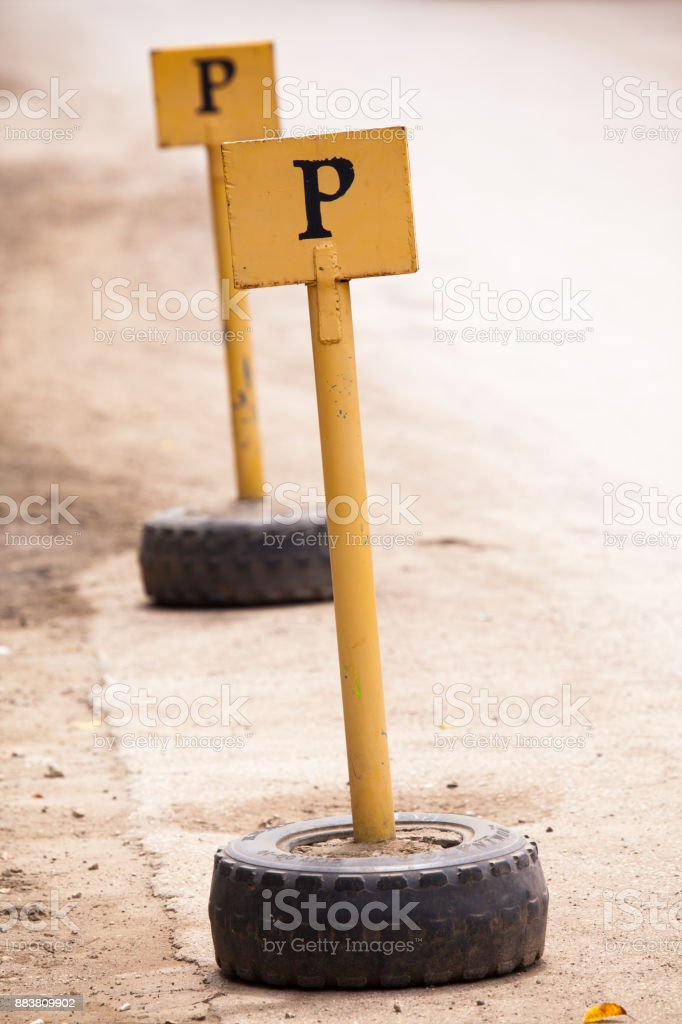Parking Signs Made From Poles And Used Tyres stock photo