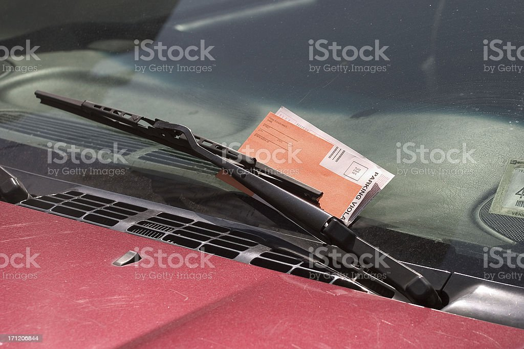 Parking ticket behind a wiper royalty-free stock photo
