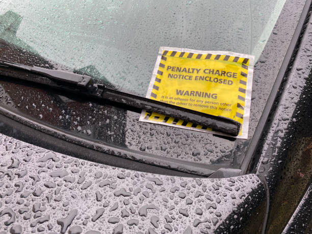 Parking Ticket on a Rainy Day. stock photo