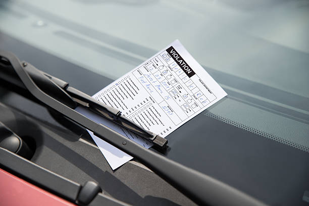 parking ticket on car - ticket stock photos and pictures