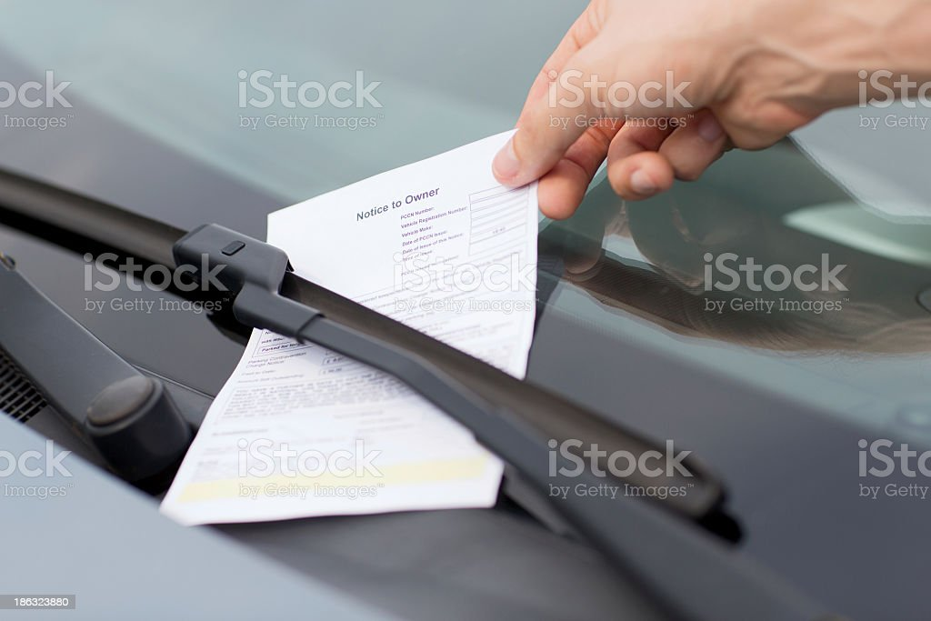 parking ticket or fine on car windscreen stock photo
