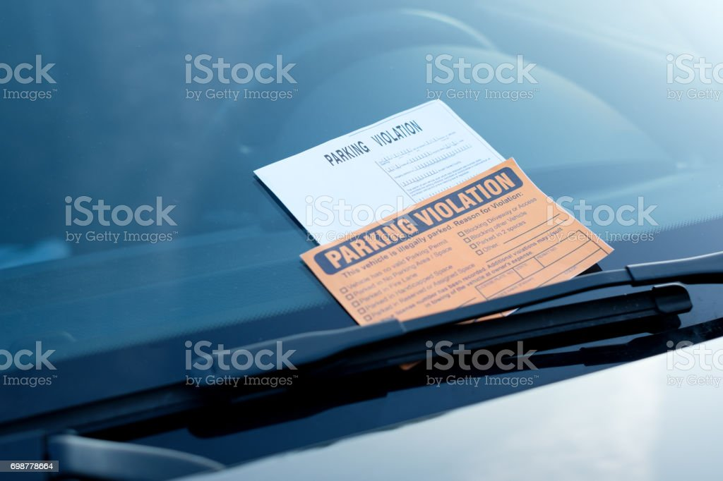Parking violation ticket fine on windshield stock photo