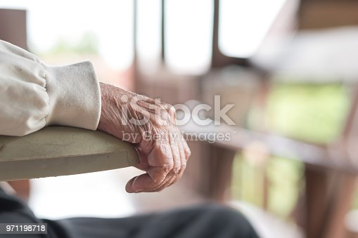 istock Parkinson disease patient, elderly senior person in support of nursing family caregiver for disability awareness day concept 971198718