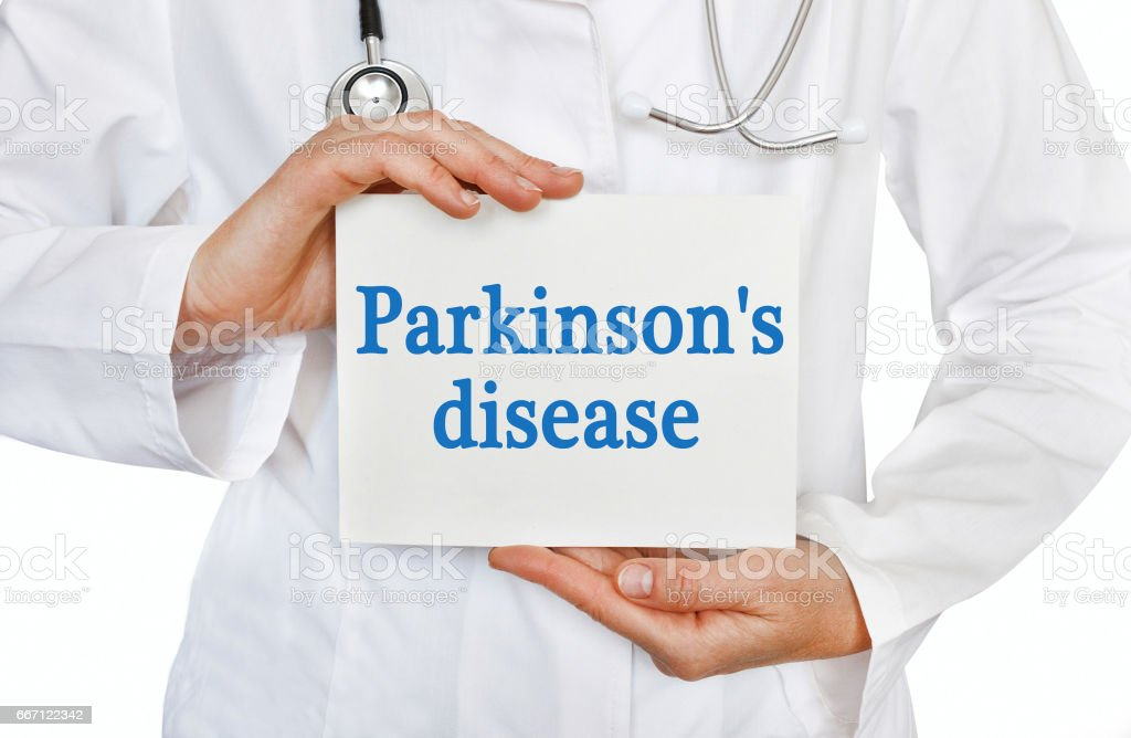Parkinson's disease card in hands of Medical Doctor stock photo