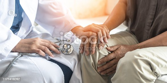 istock Parkinson's disease patient, Arthritis hand and knee pain or mental health care concept with geriatric doctor consulting examining elderly senior aged adult in medical exam clinic or hospital 1171416262