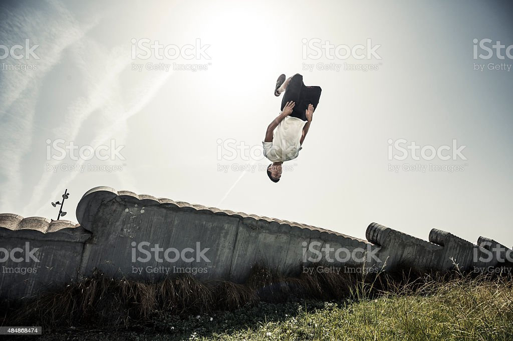 Parkour in the city man doing a backflip stock photo