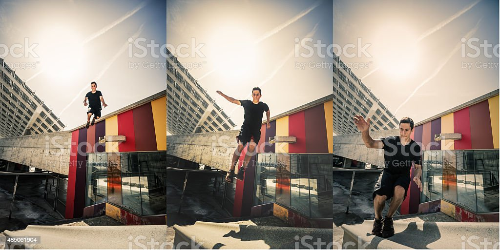 Parkour in the city Man doing a long jump stock photo