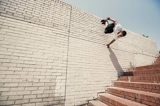 parkour in the city - daredevil stock pictures, royalty-free photos & images