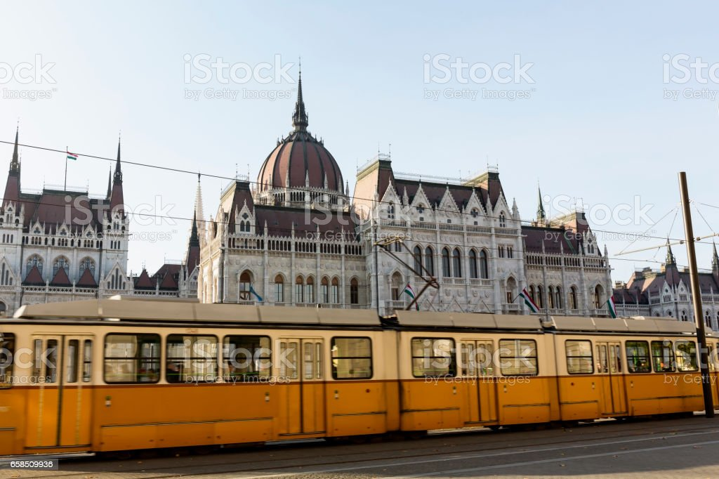 Parliament and a typical Yellow Tram on Kossuth Square in Budapest stock photo