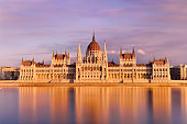 Parliament building in dramatic sky at sunset, Budapest, Hungary.