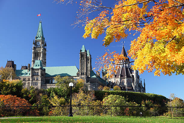 parliament hill in autumn - canada parliament stock photos and pictures