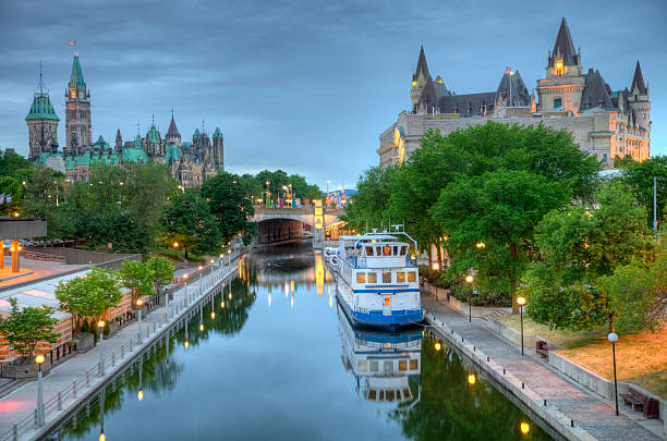 parliament hill  on the rideau canal - canada parliament stock photos and pictures