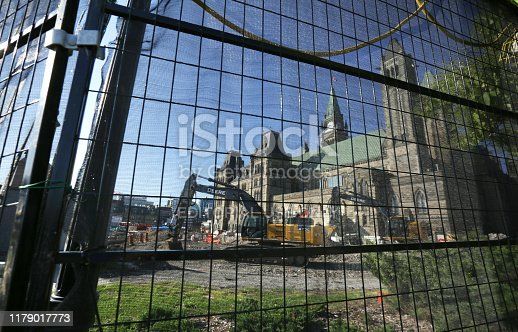 Ottawa, Canada - August 25, 2019: Extensive upgrading of Parliament Hill   includes excavations near the East Block. Background shows the Peace Tower of the Centre Block. Clear skies above the National Capital Region.