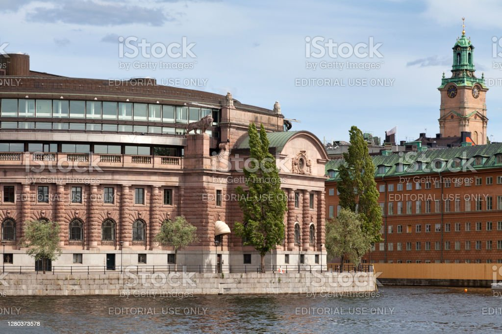 Parliament House and the Stockholm Cathedral Stockholm, Sweden - June 24 2019: The Parliament House (Swedish: Riksdagshuset), is the seat of the parliament of Sweden, the Riksdag. It is located on nearly half of Helgeandsholmen (island), in the Gamla stan (old town) district of central Stockholm. Architecture Stock Photo