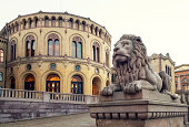 The Parliament of Norway Building  with lion sculpture, Oslo Norway