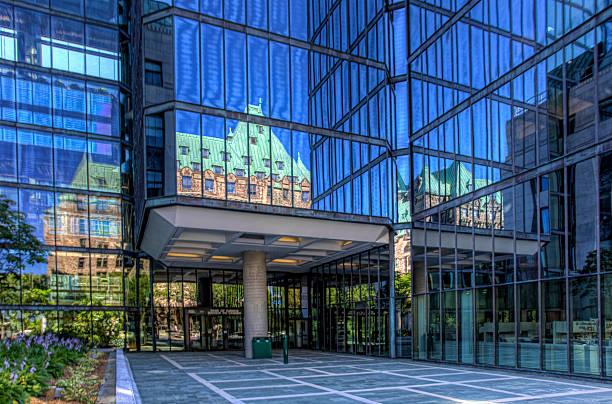 Parliament reflected in Bank of Canada building, Ottawa stock photo