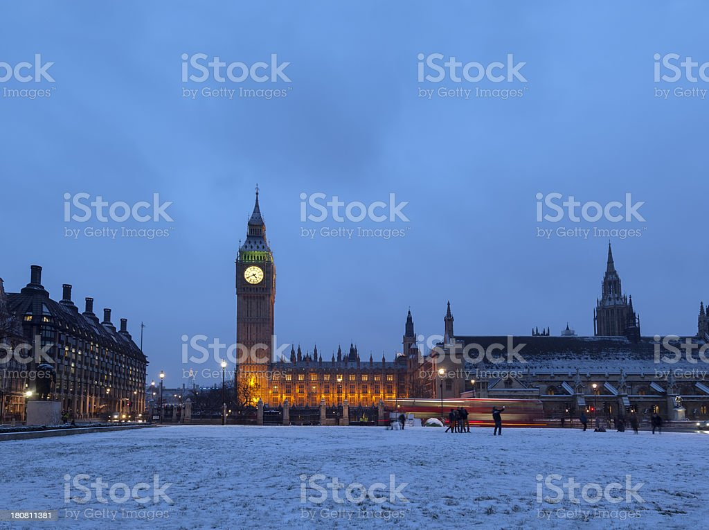 Parliament Square with Big Ben in snow and dusk royalty-free stock photo