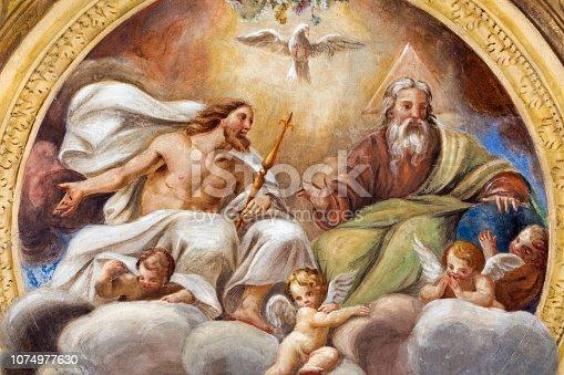 istock Parma -  The ceiling freso of The Holy Trinity in church Chiesa di Santa Croce by Giovanni Maria Conti della Camera (1614 - 1670). 1074977630