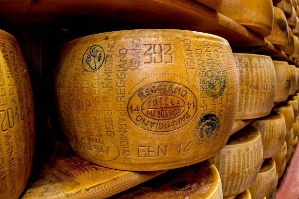 Parmagiano Reggiano cheese aging stock photo