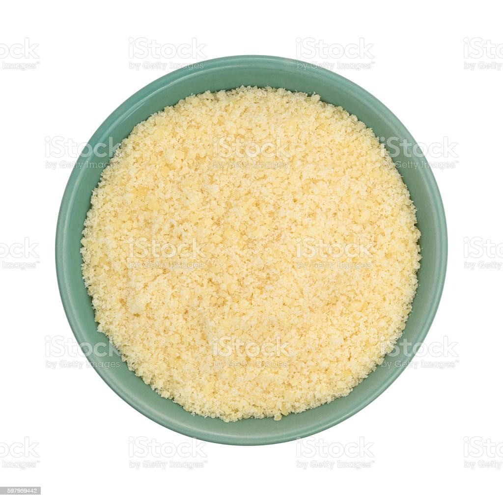 Parmesan cheese in a green bowl stock photo