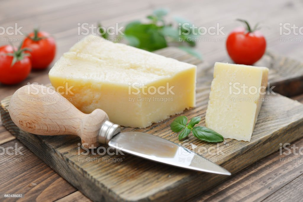 Parmesan cheese on cutting board royalty-free stock photo