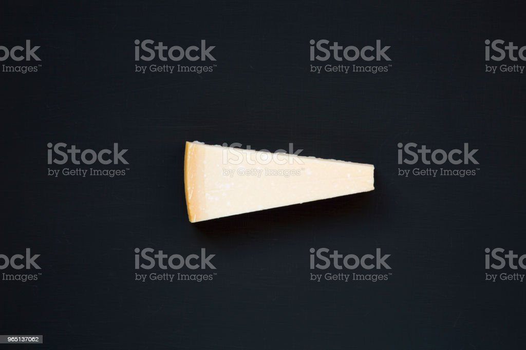 Parmesan cheese on dark background, top view. From above. royalty-free stock photo