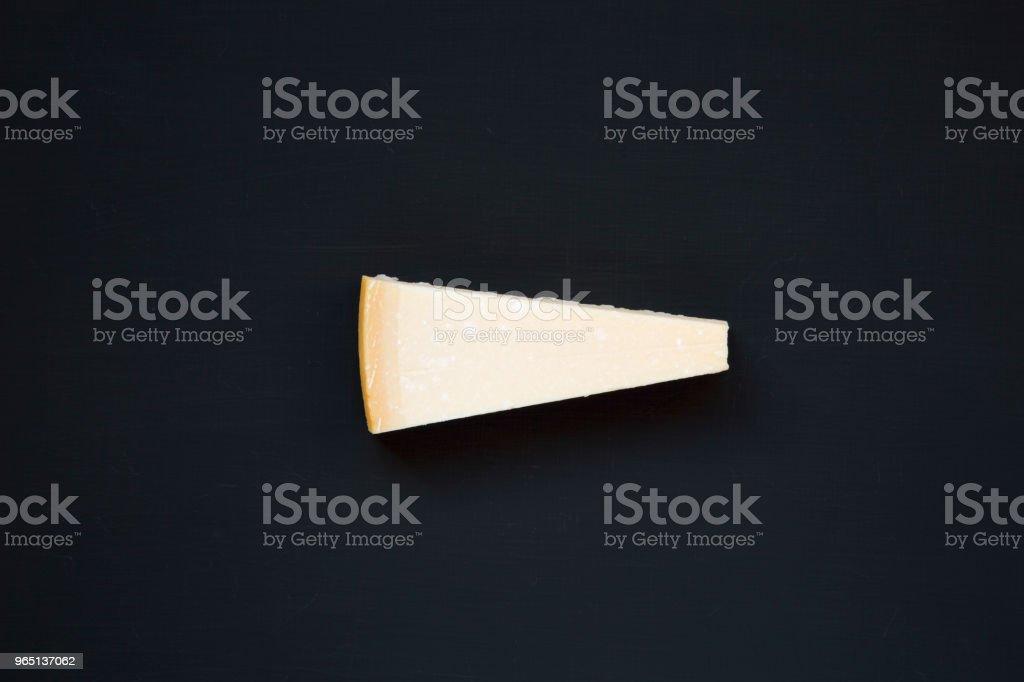 Parmesan cheese on dark background, top view. From above. zbiór zdjęć royalty-free