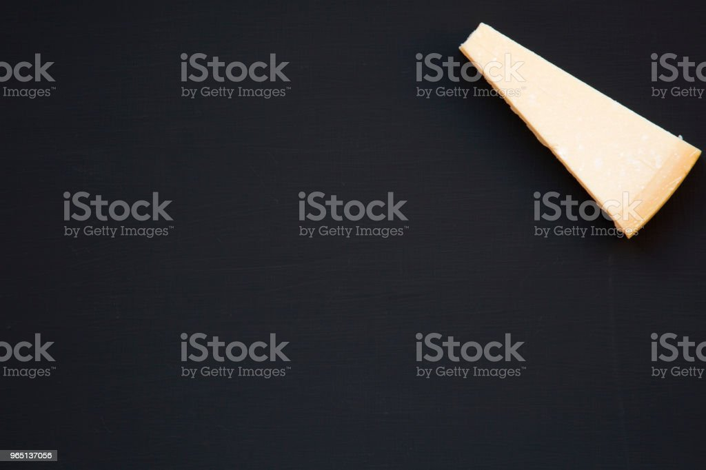 Parmesan cheese on dark background with copy space, top view. From above. royalty-free stock photo