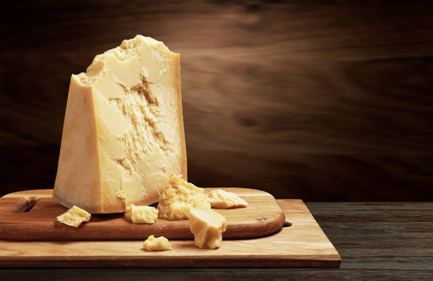 Parmesan cheese on wood Parmesan cheese on wooden board parmesan cheese stock pictures, royalty-free photos & images
