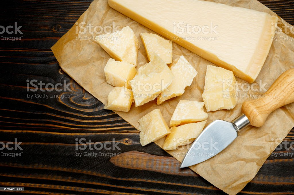 parmesan cheese on wooden background royalty-free stock photo