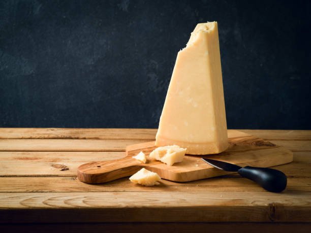 Parmesan cheese on wooden table stock photo