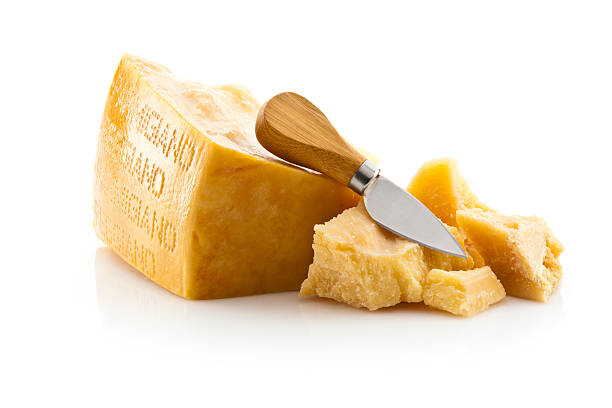 Parmesan Cheese Parmesan Cheese with Knife Isolated on White Background parmesan cheese stock pictures, royalty-free photos & images