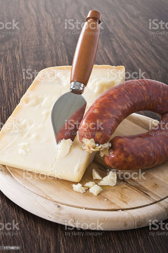 Parmesan cheese piece with spicy sausage. royalty-free stock photo