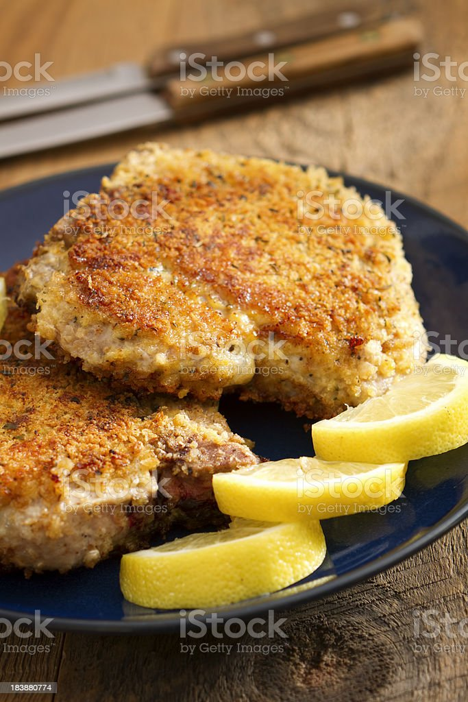 Parmesan-Crusted Pork Chops stock photo