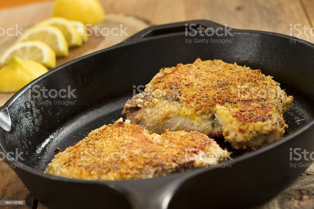 Parmesan-Crusted Pork Chops stock photo