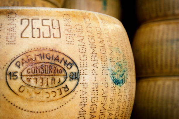 parmiggiano reggiano (typical italian cheese) - parmesan stock photos and pictures