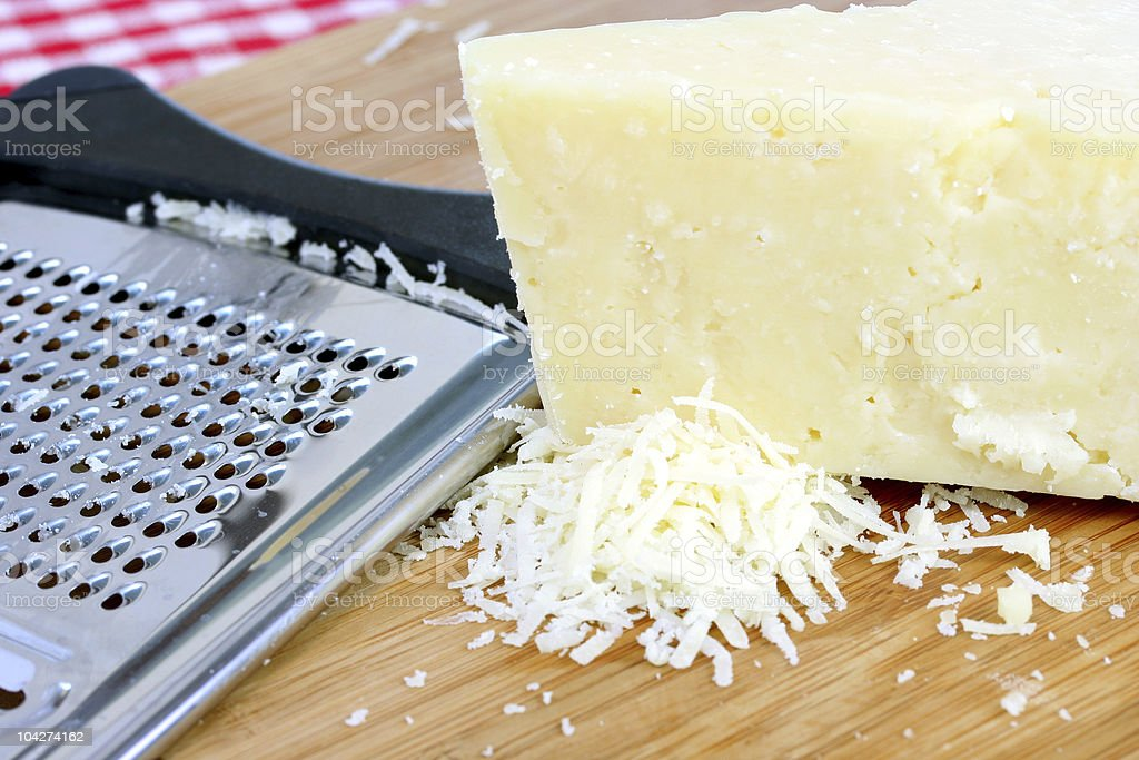 Parmigiana Cheese and Grater stock photo