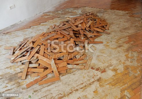 Benevento, Campania, Italy - October 1, 2016: parquet cherry planks being demolished after damage caused by a domestic flooding