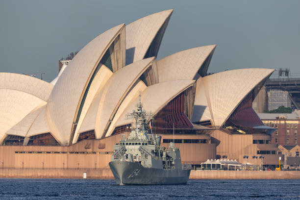 HMAS Parramatta (FFH 154) Anzac-class frigate of the Royal Australian Navy in Sydney Harbor with the Sydney Opera House in the background. Sydney, Australia - October 5, 2013: HMAS Parramatta (FFH 154) Anzac-class frigate of the Royal Australian Navy in Sydney Harbor with the Sydney Opera House in the background. naval base stock pictures, royalty-free photos & images
