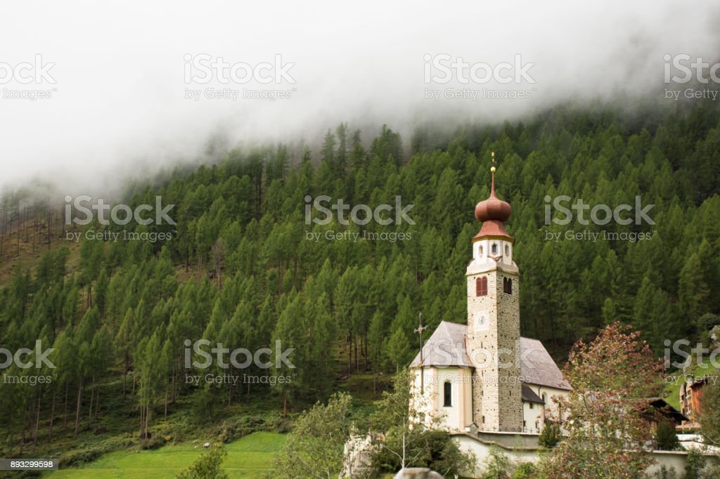 Parrocchia senales in Gries Picturesque church of St Antonius with its onion dome stock photo