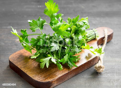 Parsley Culinary Herb on a Wooden Cutting Board