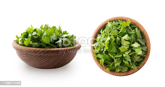 Parsley isolated on white background. Top view. Parsley leaves with copy space for text. Herbs isolated on white. Parsley leaves on white background.