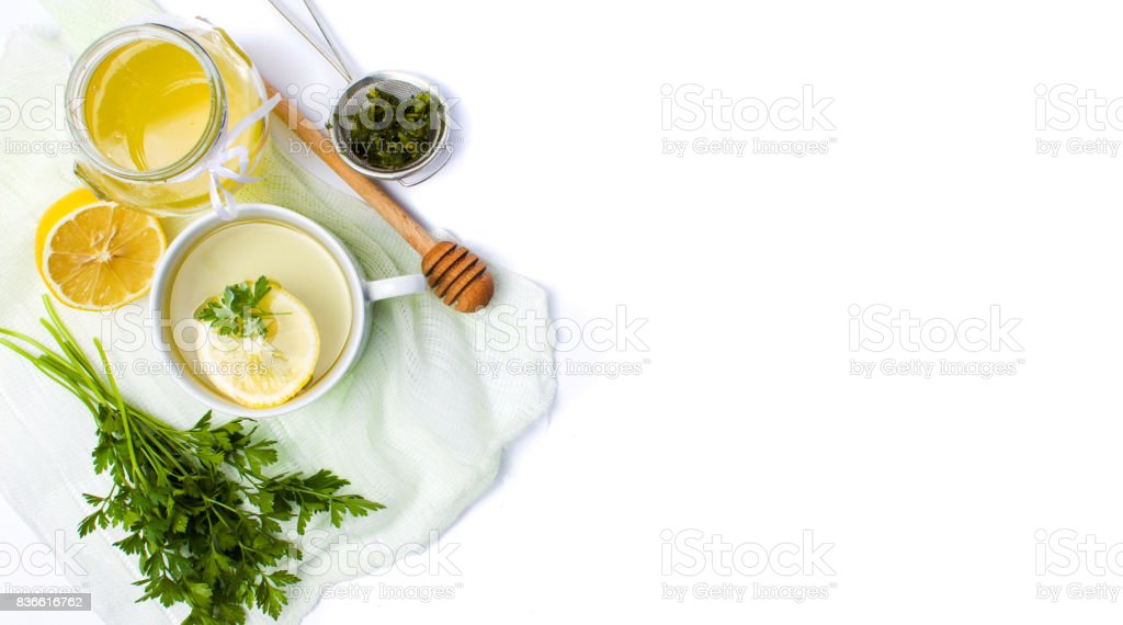 Parsley tea with lemon and honey stock photo