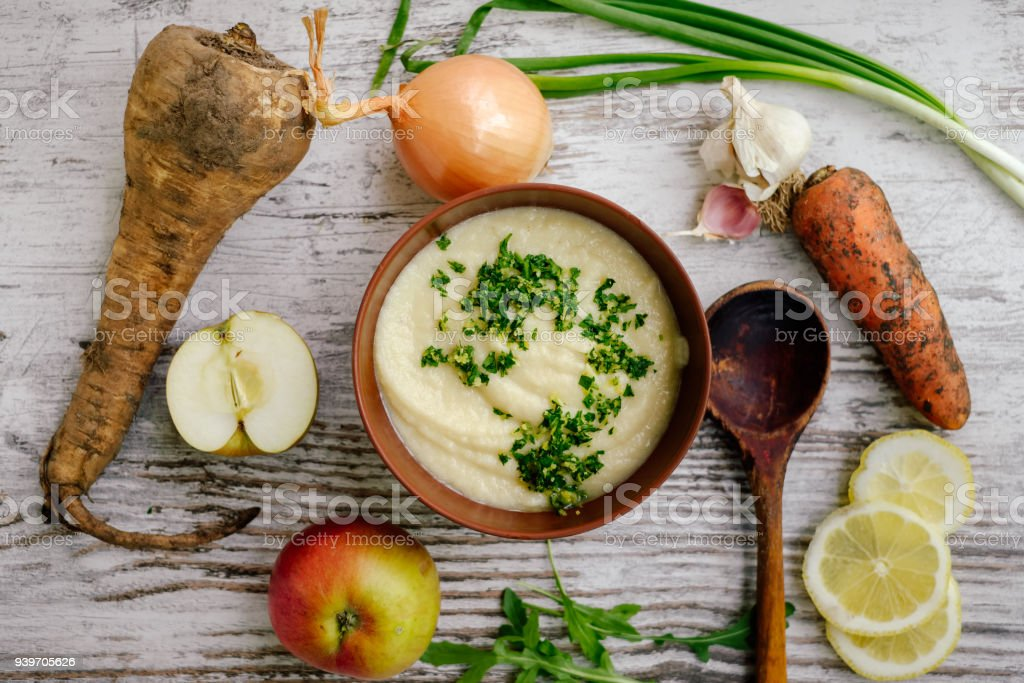Parsnip cream soup with raw vegetables stock photo