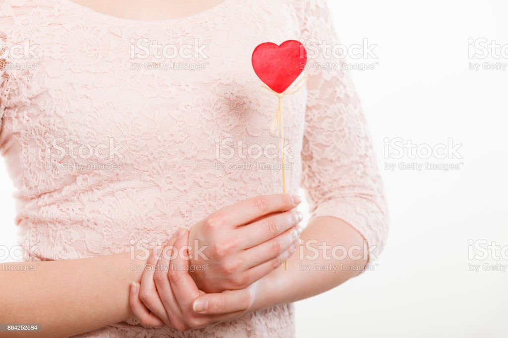 Part body woman with little red heart. royalty-free stock photo